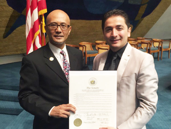Hawaii State Senator Will Espero (left) and Artur Artenyan with a signed resolution recognizing the Armenian Genocide