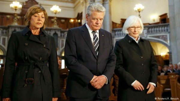 German President Joachim Gauck, middle, and his partner Dabiela Schadt, left, attend an ecumenical service remembering the Armenian slaughter at the Berlin Cathedral Church in Berlin, Germany, Thursday, April 23, 2015.